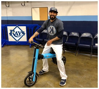 Tampa Bay Rays Pitcher Sergio Romo posing on his blue Go-Bike M2