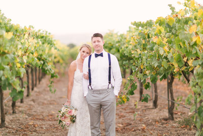 Bride stands with groom at Firestone Winery wedding
