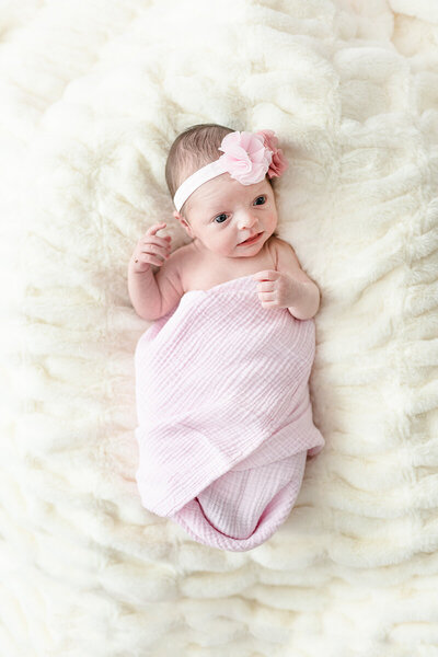 newborn-swaddled-in-pink-blanket