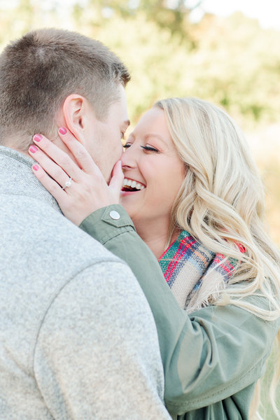 bride kissing groom during engagement session