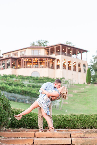 Photo of a couple kissing and dipping at Montaluce Winery in Dahlonega Georgia.