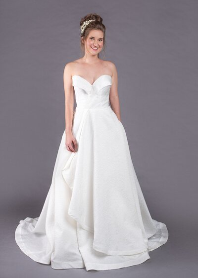 Photo link to more details about the strapless Eloise a-line wedding dress