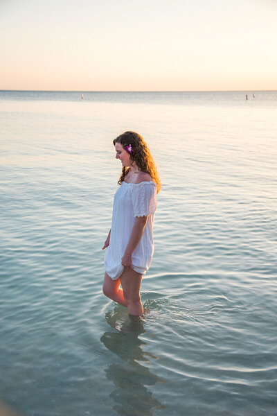 Girl walking in the ocean in Fort Myers