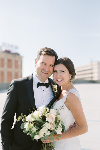 A beautiful portrait of a Birmingham bride and groom on a rooftop in Alabama