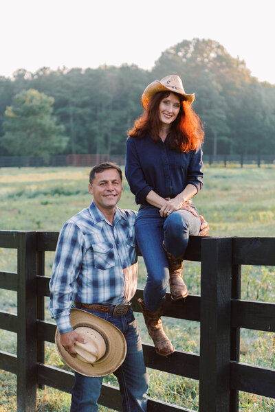 Owners of Callidora Ranch cowboy and cowgirl wearing hats near Atlanta