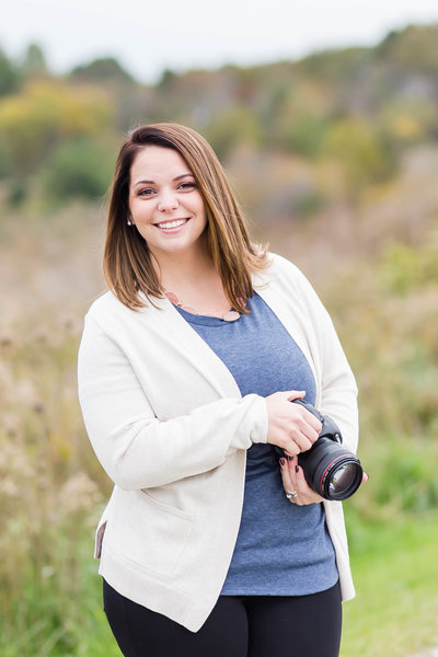 Akron Ohio Wedding photographer headshot holding canon mark iii camera