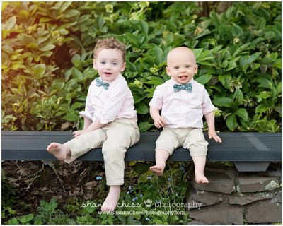 Boys in bow ties | Wearing pink long sleeved button up shirts, bow ties, and barefoot in the park