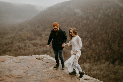 eloping couple hiking together