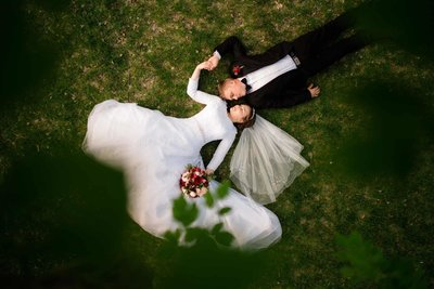 Bride and Groom laying on floor