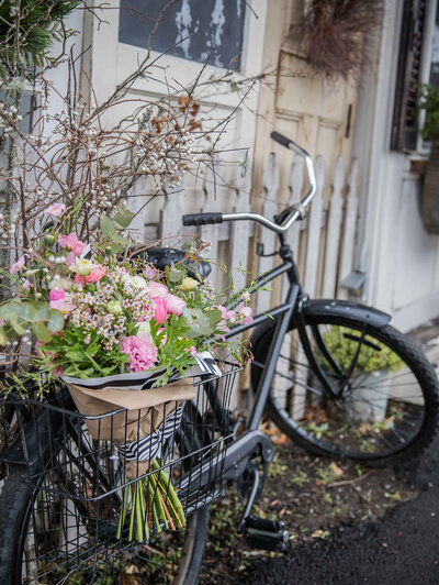 Nancy Ingersoll loves her bike and fresh flowers, so she took this photo for a local florist's brand photography styled shoot