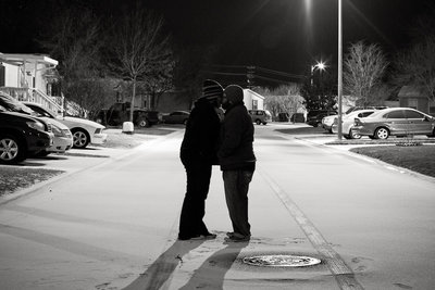 David Castillo and Irene Castillo of Expose The Heart Photography kissing in the snow