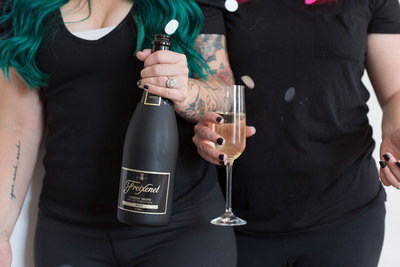 Britt and Kelsey of Launch Your Daydream celebrating creative business branding with champagne