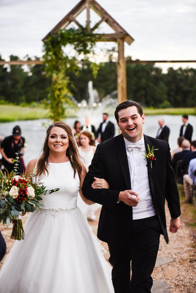 Bride and Groom walking up the aisle at Greengates Farmhouse in Laurel, MS