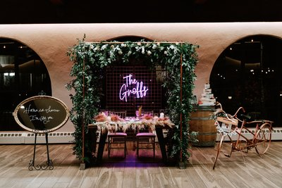 Unique Wedding Reception Head table with neon sign and floral arch