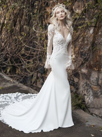 Bell Sleeve Mermaid Wedding Gown. You're a born romantic. It was your interest in this lace bell-sleeve mermaid wedding gown-dripping with pearls, luxuriously bohemian-that gave it away.