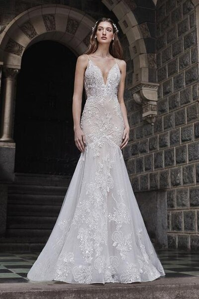 Beaded lace Mermaid silhouette Flirty spaghetti strap Illusion deep v-neckline Intricate 3D detail Cascading train