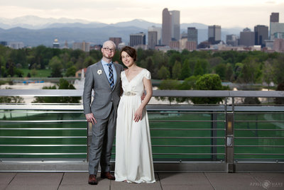 Wedding couple portrait with Denver Skyline in backdrop DMNS