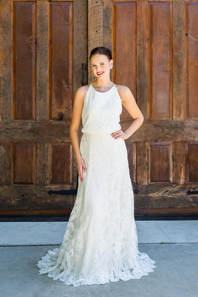 Model wears the Sabine wedding dress in lace and crepe