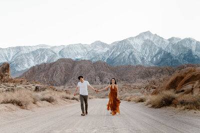 couple holding hands in the desert