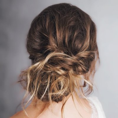 modern messy look hair style for brides