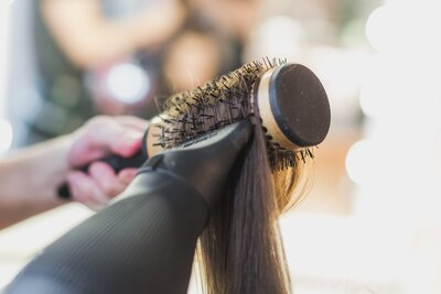 blowdrying-hair-on-round-brush