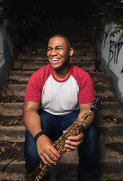 commercial portrait of Atlanta musician playing saxophone on concrete steps Old Fourth Ward