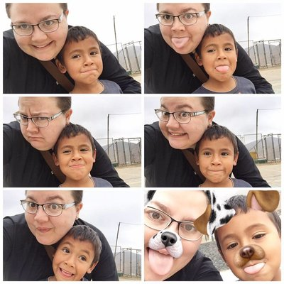 Allison Mayer Working on Assignment in Peru selfies with young boy niño Voices4Peru V4P Ventanilla Lima Callao Peru