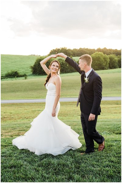 Elegant-White-Barn-Wedding-groom-twirling-bride