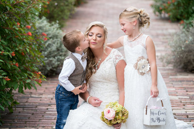 austin wedding photographer boy kisses bride on cheek flower girl austin texas