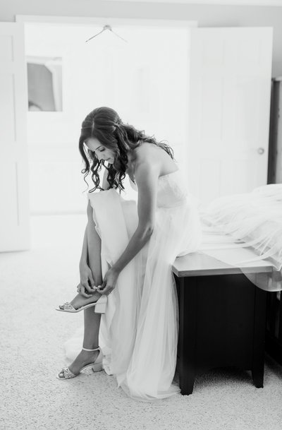 Wedding Photography, bride getting ready and putting on her heels