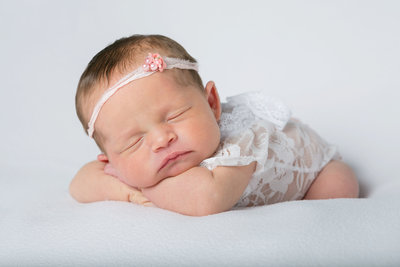 Precious baby girl posed for newborn mini session