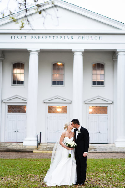 Couple kisses in front of First Presbyterian  Biloxi, Biloxi MS Wedding