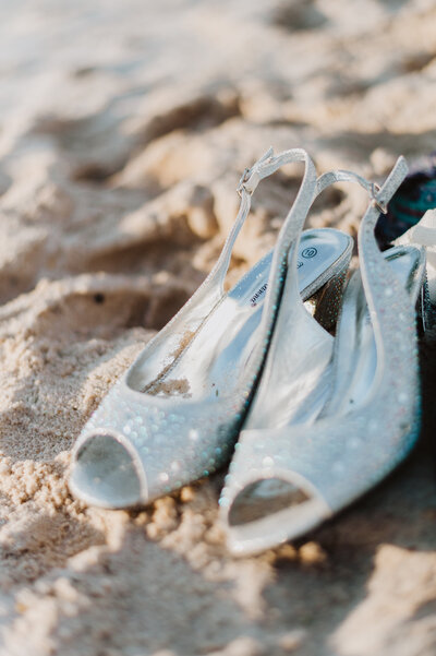 bride's shoes on the sand