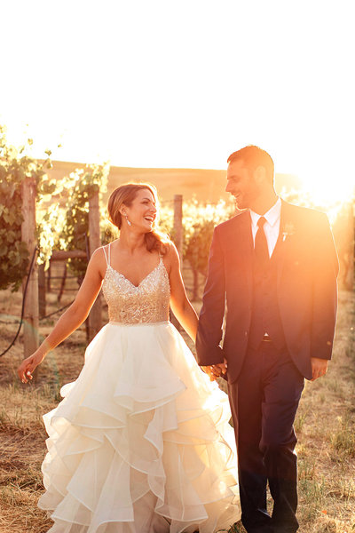 Wedding Photography, bride and groom walking in a vineyard