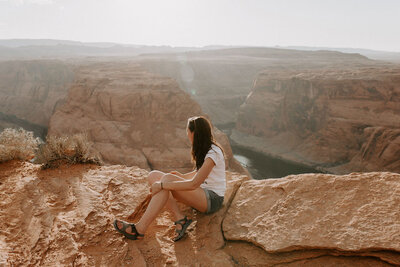Heather sitting on the edge of the Grand Canyon