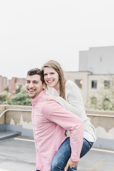 Bride on grooms back engagement photo pose ideas