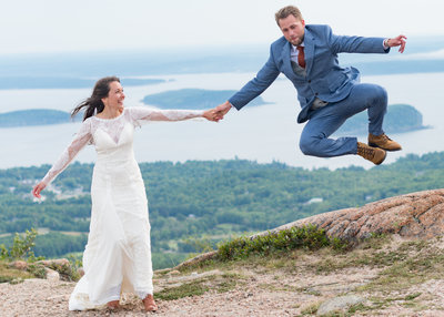couple eloping in acadia national park on top of a mountain