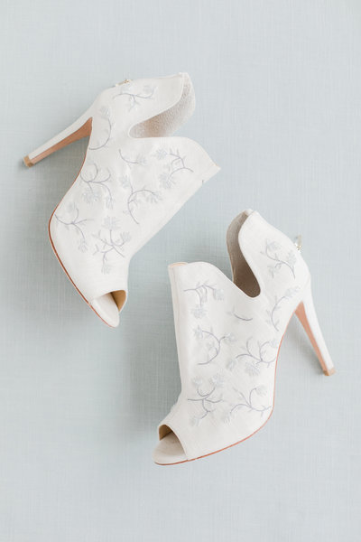 blue and white designer wedding shoes by costola photography