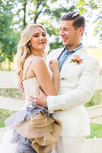 Country couture bride wearing Vera Wang wedding gown with her groom wearing white linen at the Blackberry Farm wedding venue in Knoxville TN