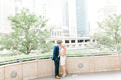 couple snugling almost kissing in chicago riverwalk
