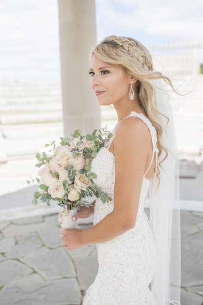 Bride with her flowers on wedding day