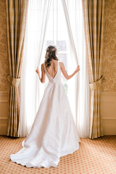 bride looking out window at Carmel Country Club Wedding