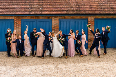 bridal-party-pulling-silly-poses-tithe-barn-perterfield