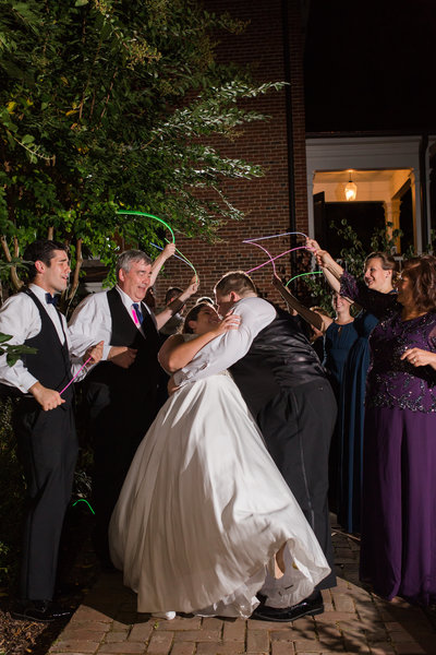 A glowstick exit of a bride and groom at Braehead Manor in Fredericksburg