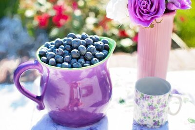 black-berries-on-purple-container-beside-white-and-purple-34766