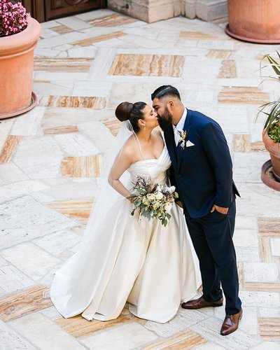 romantic wedding couple portrait kiss at mission inn hotel and spa in riverside