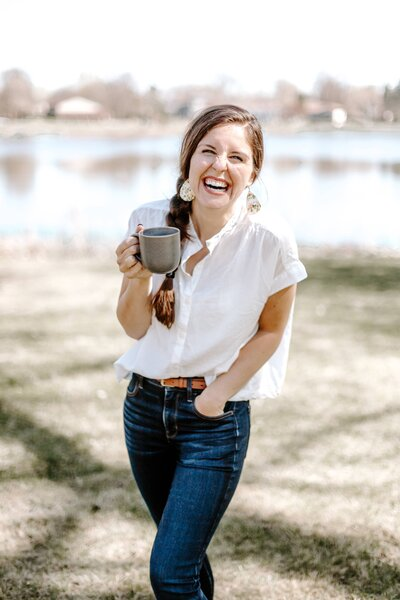 woman smiling holding coffee