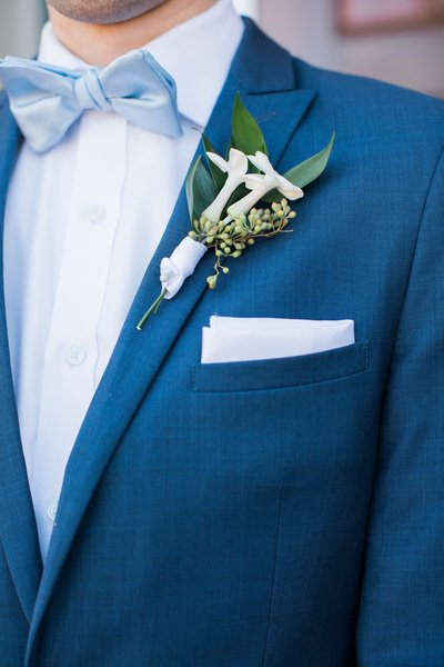 Wedding Photographer, close up of groom's suit pocket