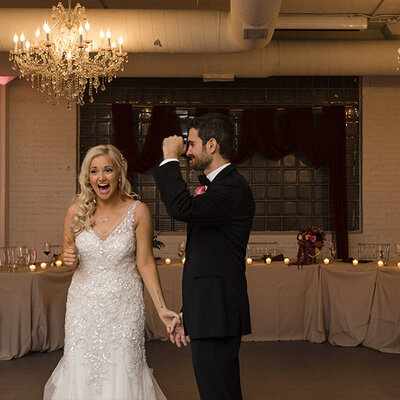 Bride and groom are excited after having their first dance at Room 1520 in Chicago, IL