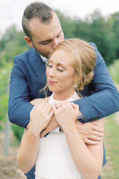 bride and groom share a romantic moment at their Northern Michigan wedding photo by Cynthia Boyle, wedding photographer in Northern Michigan